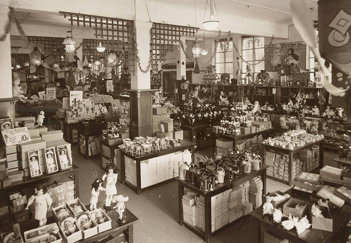 Black and white photo of a department store displaying toys. - click to view larger image