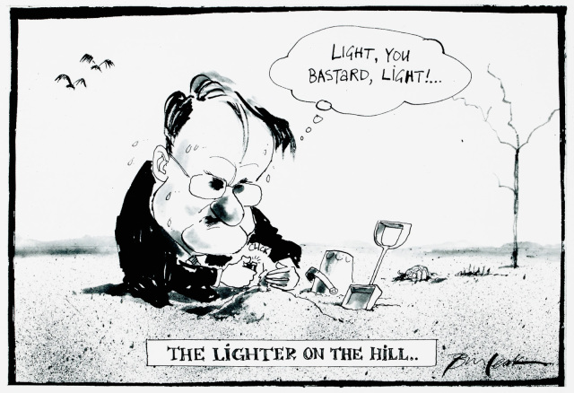A cartoon of a man trying to light a candle on a small mound of sand. The is a bucket and spade near by. He says 'Light, you bastard, light!' - click to view larger image