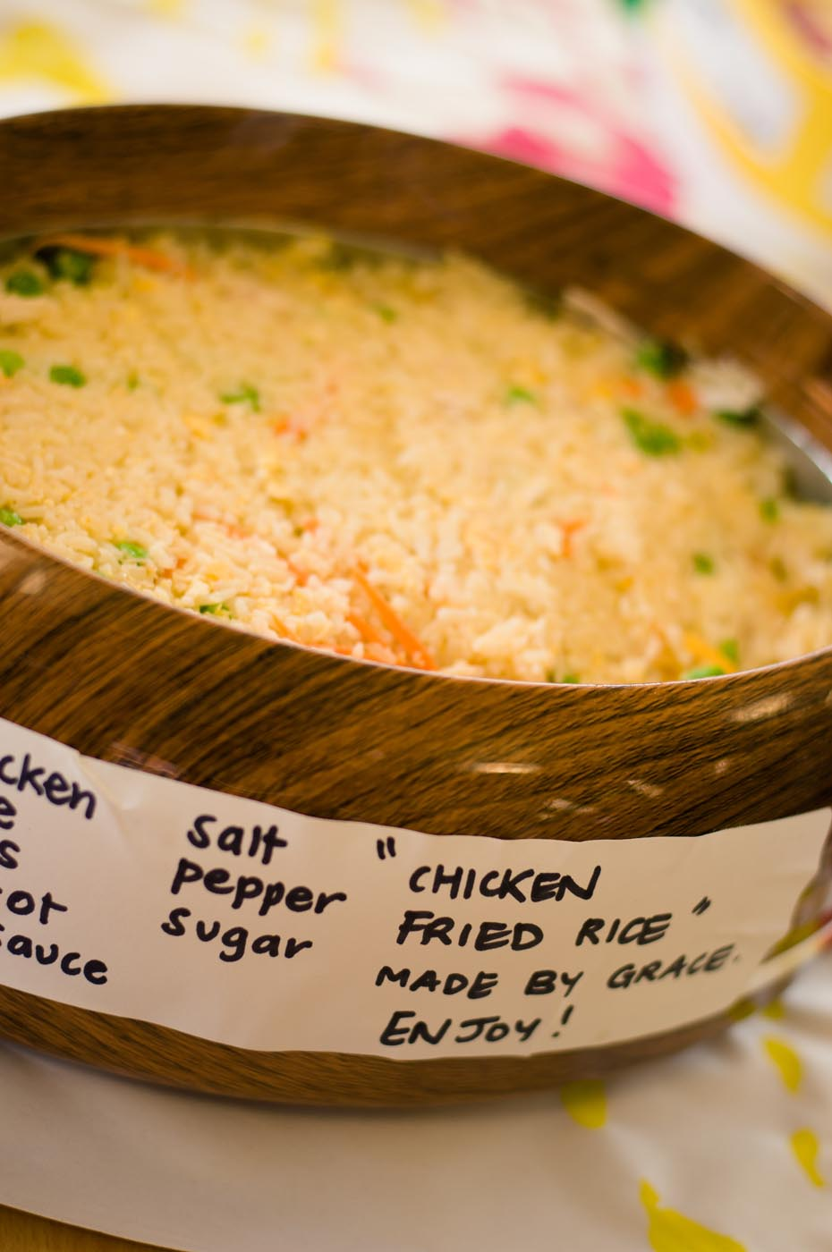 Photo of chicken fried rice in a wooden container with the ingredients listed around the outside - click to view larger image