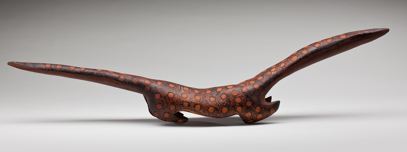 Ngintaka sculpture carved from red gum timber.