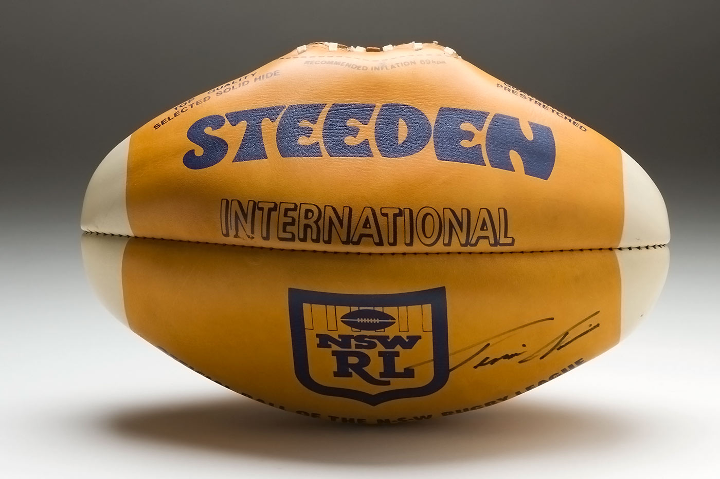 Steeden brand rugby ball with a NSWRL logo and a handwritten signature bottom right. - click to view larger image