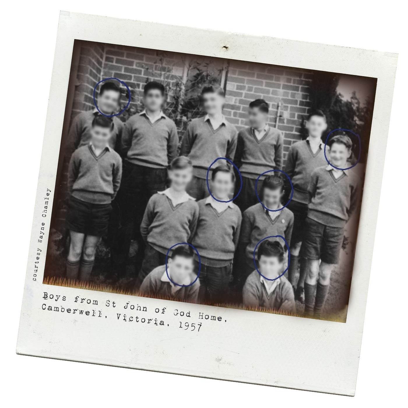 Polaroid photograph showing a group of boys in school uniform, standing in two rows, with another two boys kneeling at the front. The boys' faces have been blurred. Six of the 12 have blue rings drawn around their faces. Typed text below reads 'Boys from St John of God Home, Camberwell, Victoria, 1957. 'Courtesy Wayne Chamley' is typed at the side. - click to view larger image