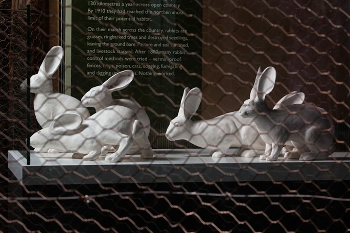 Six matt white ceramic figures modelled on the European wild rabbit. - click to view larger image