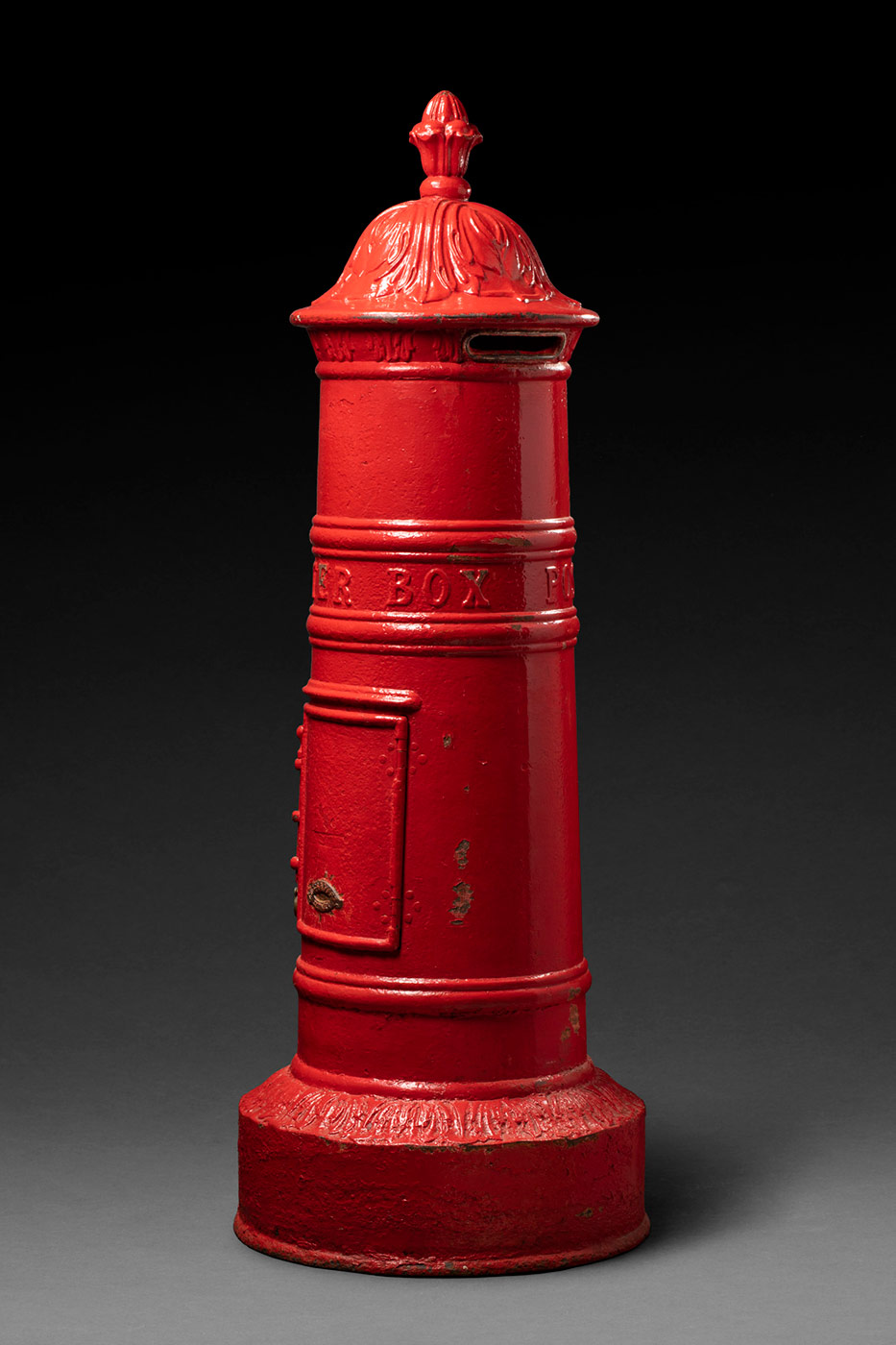 An old fashioned red postal box. - click to view larger image
