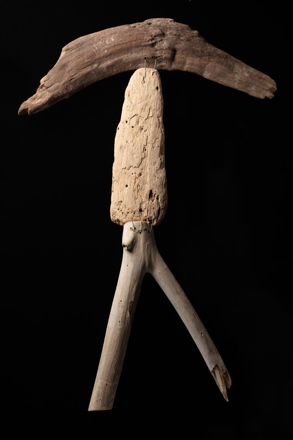A figurative artwork made from driftwood and galvanised wire. - click to view larger image