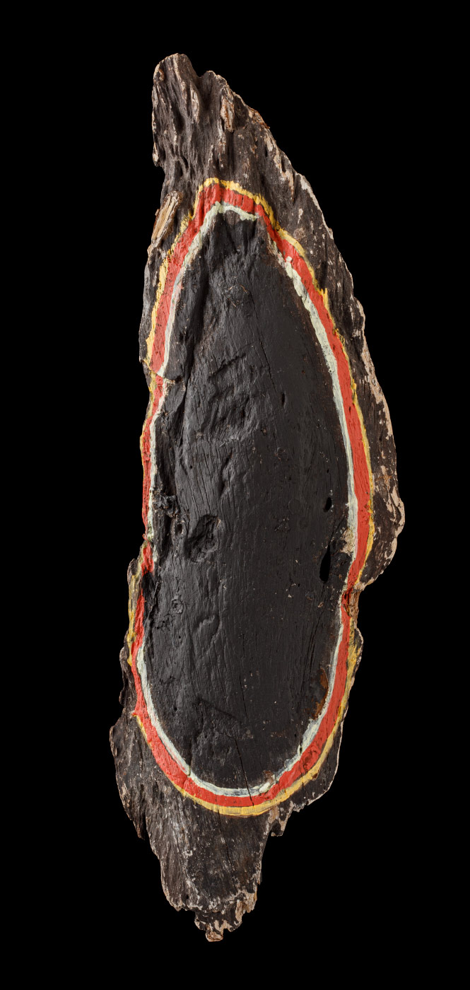 An acrylic painting on driftwood featuring an oval made of three lines painted red, yellow and white against a black background. - click to view larger image