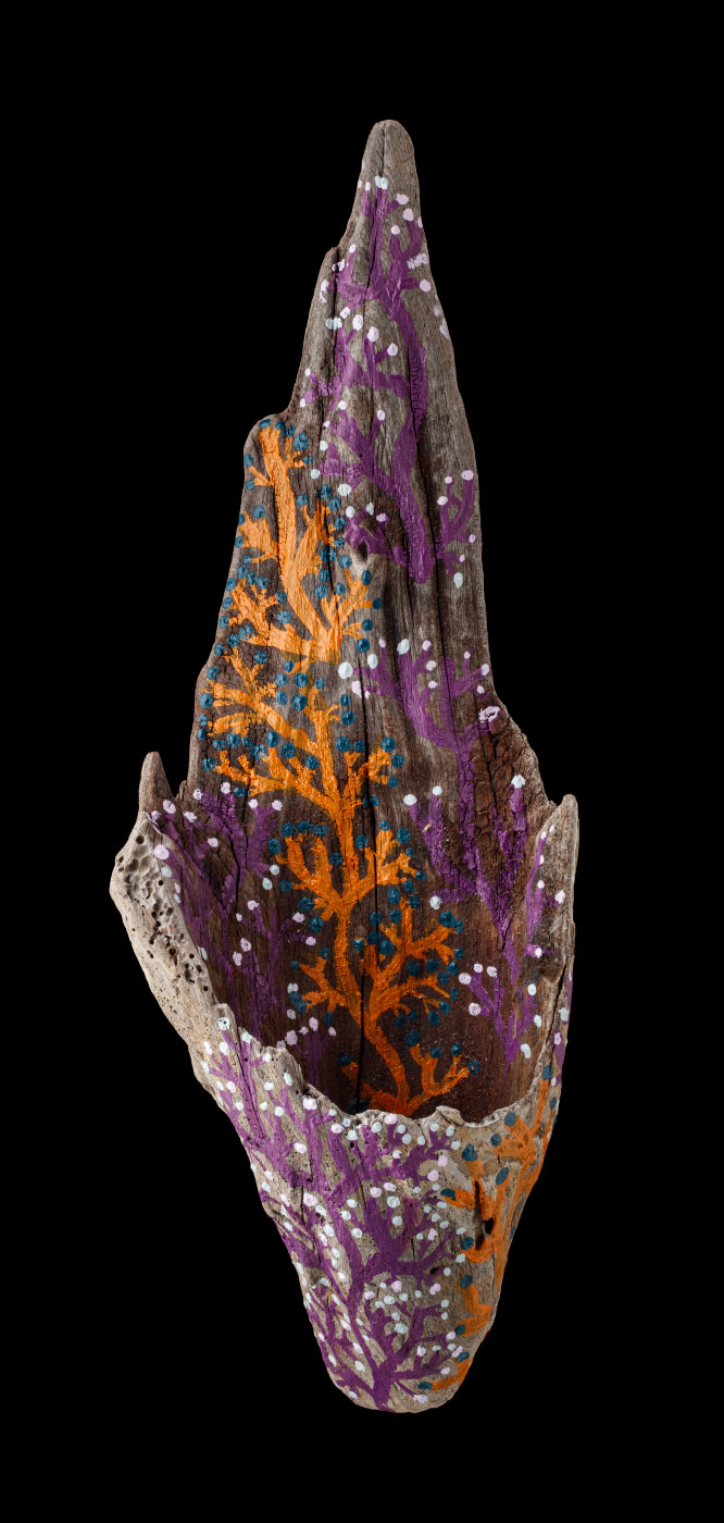 An acrylic painting on driftwood featuring orange and purple coral like motifs. - click to view larger image