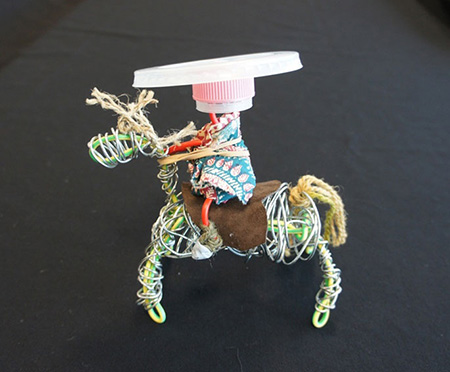 A small toy horse with rider.