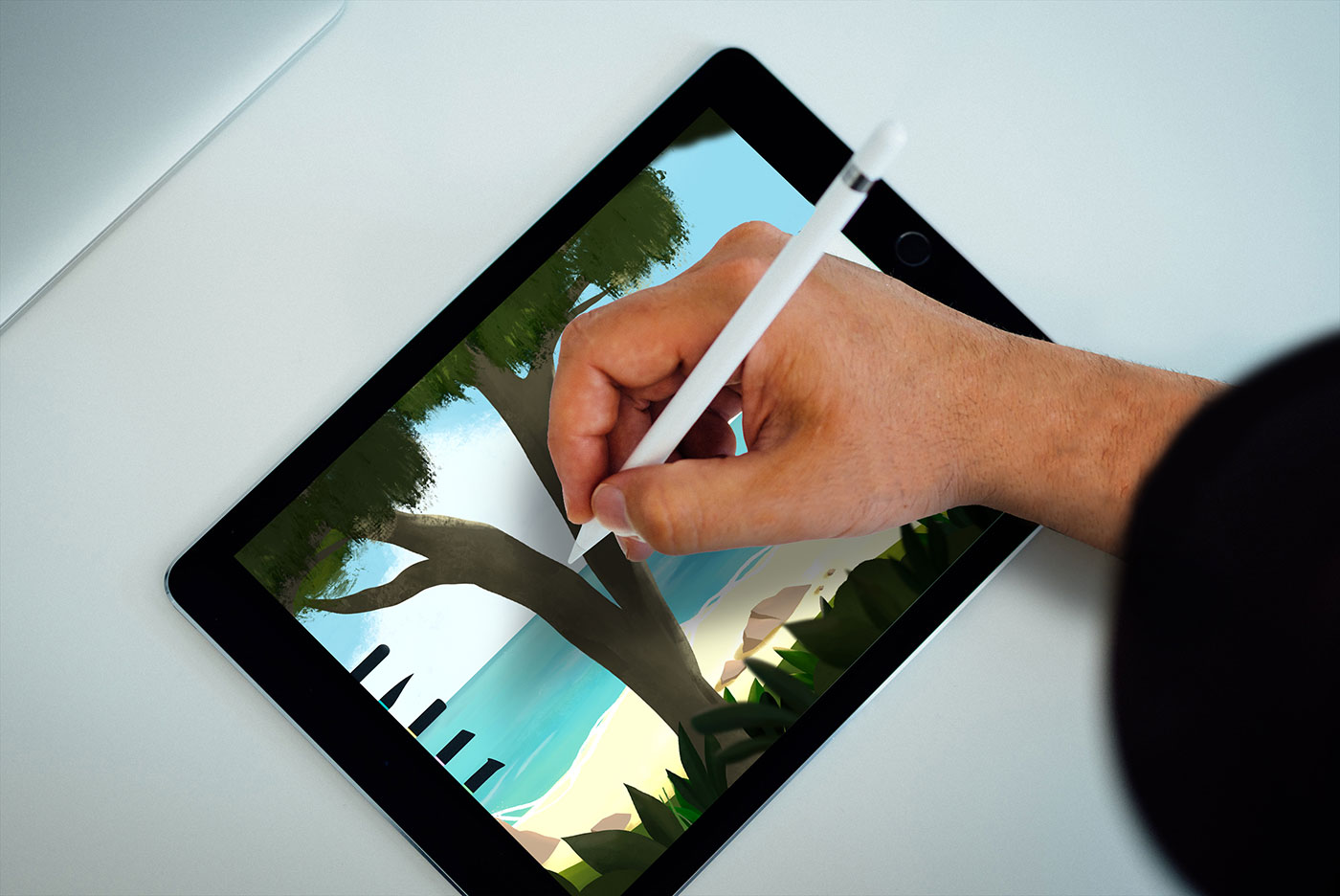 Colour photograph of hand drawing on a digital pad with a digital pen.