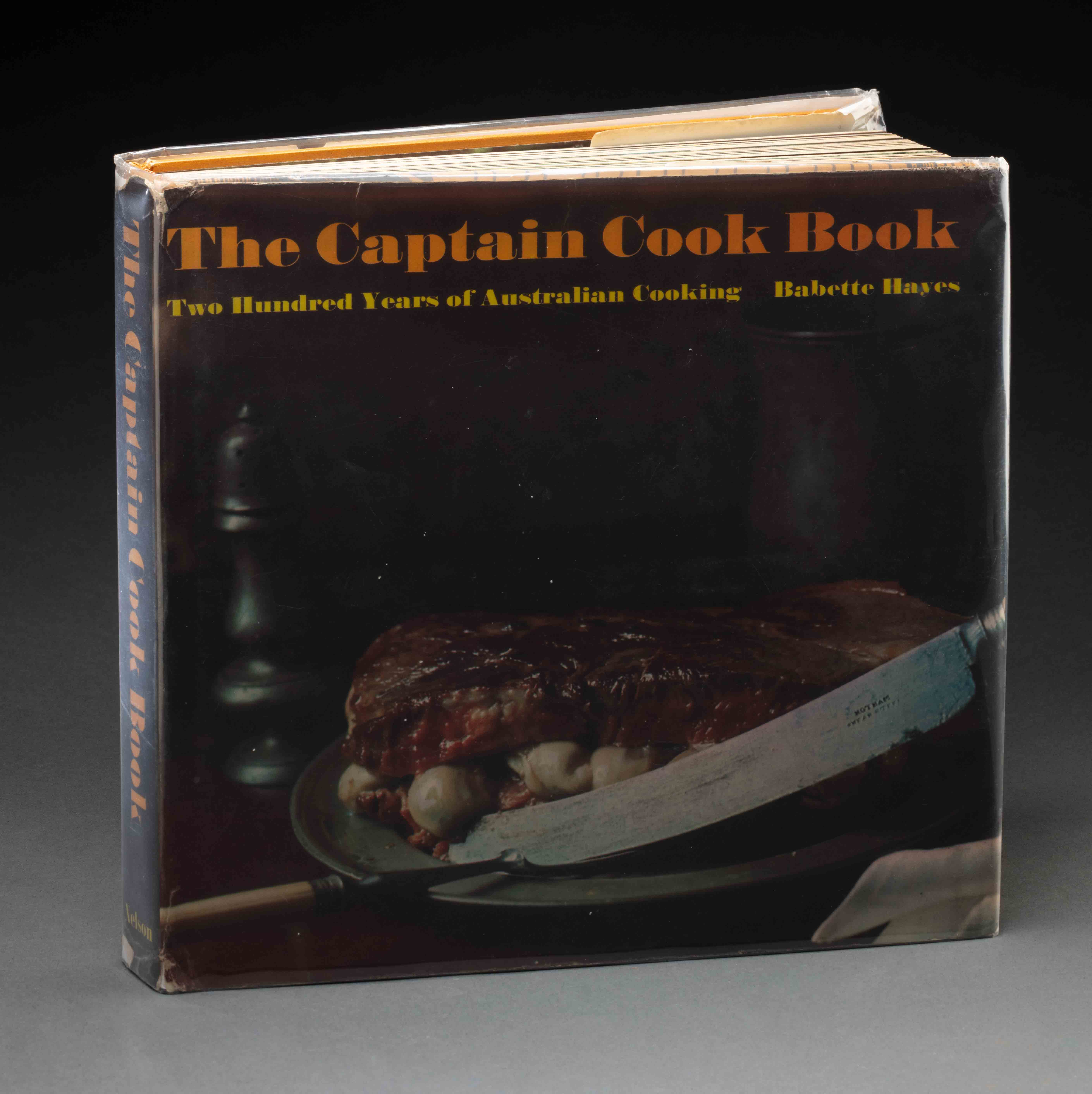 200 Years of Australian Cooking: The Captain Cook Book 1970 featuring an image of a large knife and oysters sandwiched between two thick slices of meat on the cover. - click to view larger image