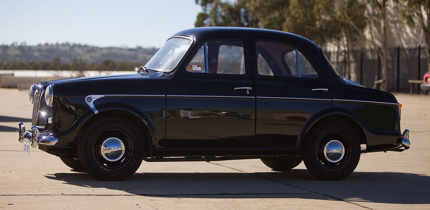 Antique black car being displayed. - click to view larger image