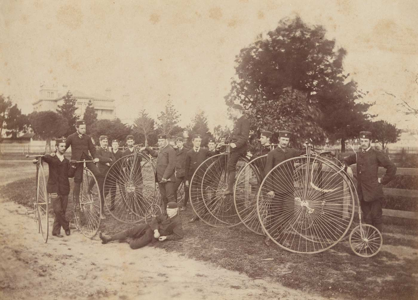 A group of men pose with penny-farthing bicycles. - click to view larger image