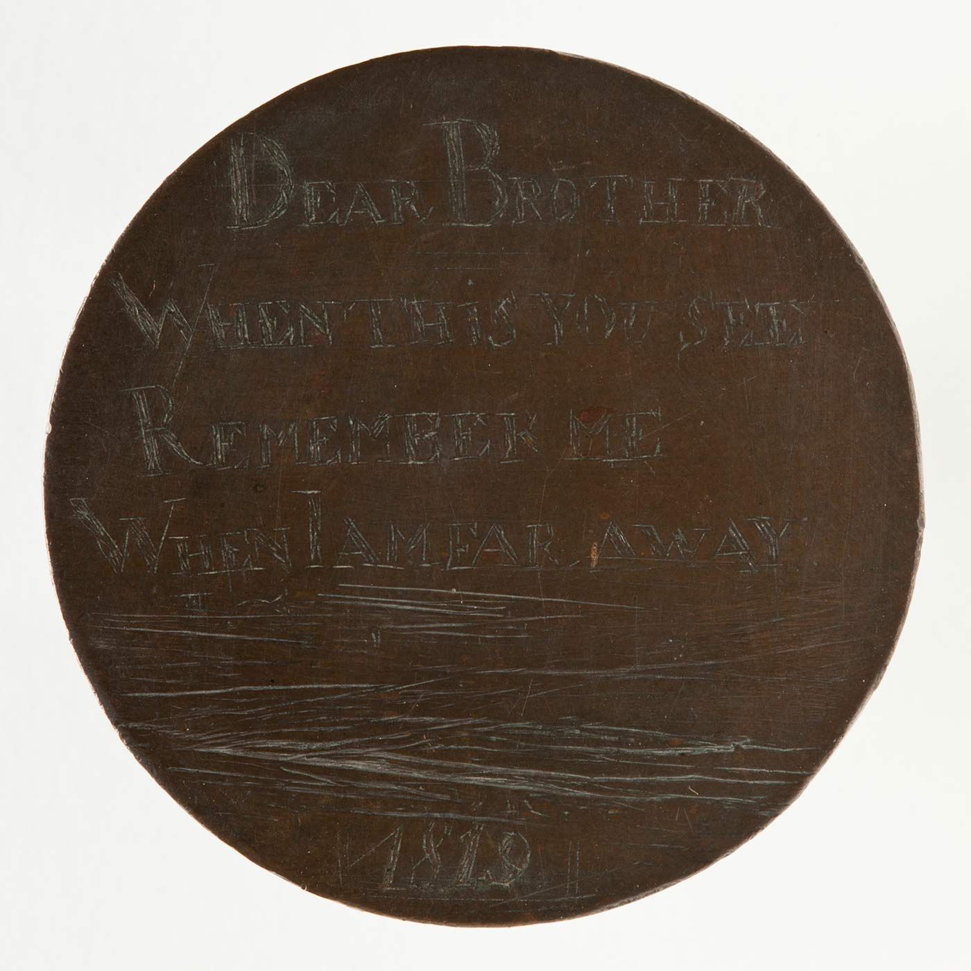 A convict love token, made up of a coin, engraved on one side. The engraved side features the text 'DEAR BROTHER / WHEN THIS YOU SEE / REMEMBER ME / WHEN I AM FAR AWAY / 1819'.