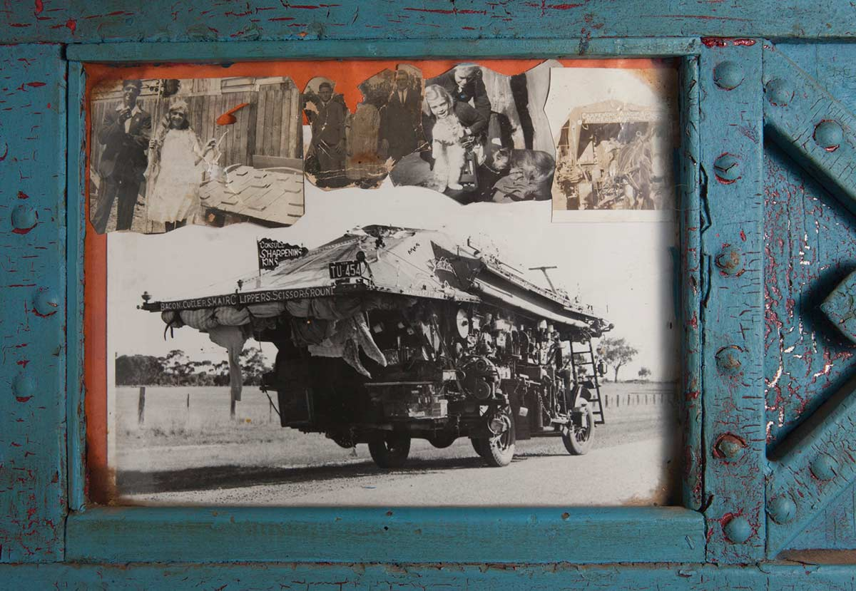 A colour photograph of a decorative frame around a black and white photo of the Saw Doctor's wagon. - click to view larger image