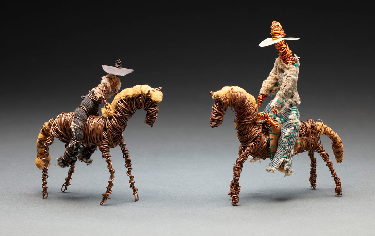 Toys of riders on horses made from found objects. - click to view larger image