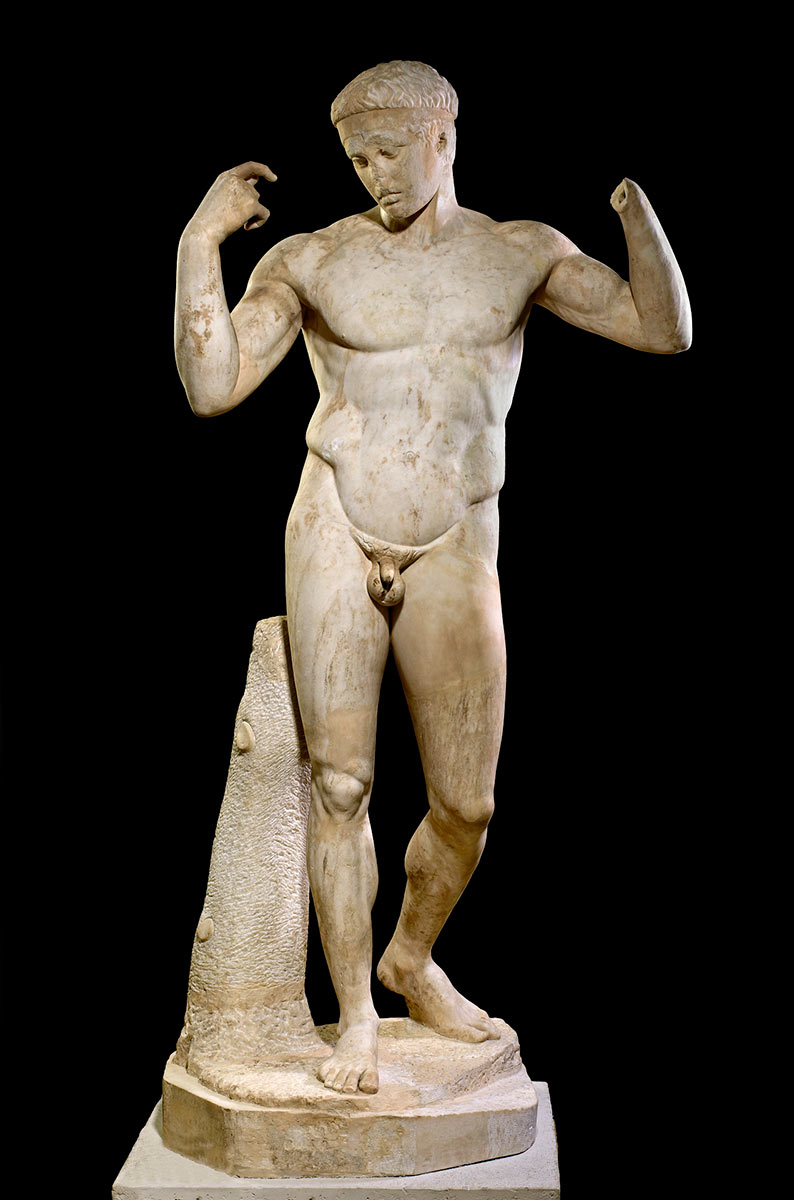 A marble statue of a naked man holding his arms up, his right hand missing. - click to view larger image