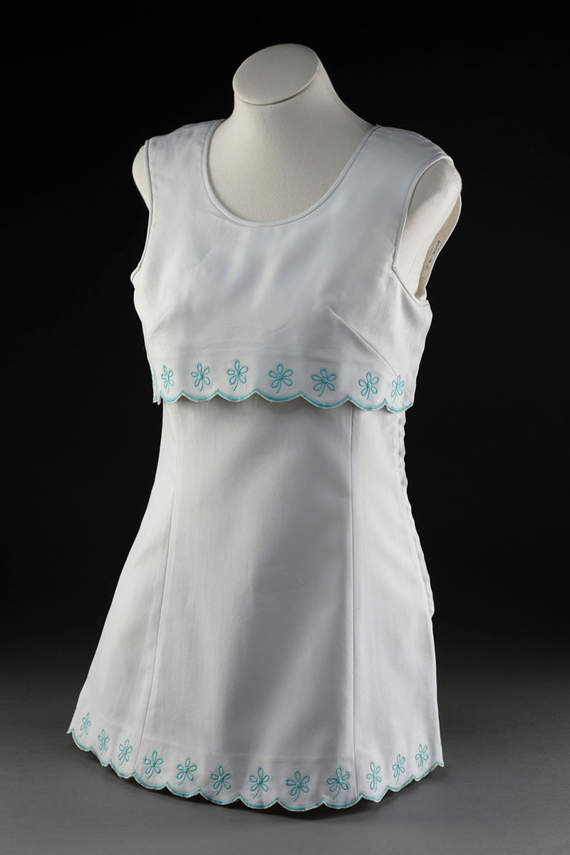 White tennis dress with pale blue trim, on a mannequin.  - click to view larger image