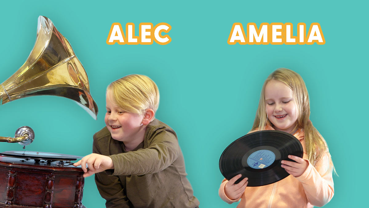 Promotional image of children Alec and Amelia holding museum objects. - click to view larger image