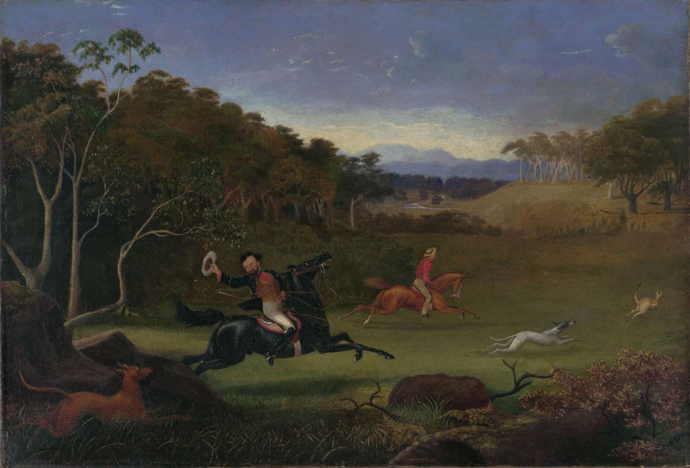 Art work showing a country landscape framed by trees either side and hills in the distance. In a grassed clearing at the front a man doffing his hat rides a black horse. Another man on a brown-coloured horse rides alongside him. Two dogs are pictured chasing a bounding kangaroo. - click to view larger image