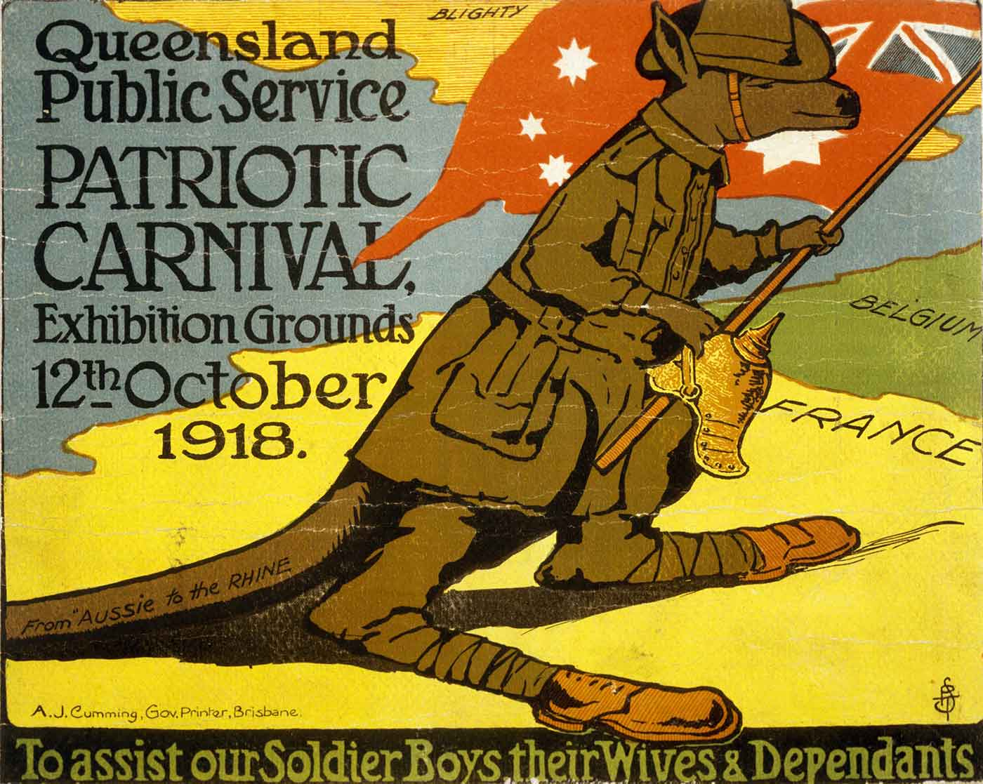 Colour poster showing a caricatured kangaroo dressed in Australian army uniform and holding a red ensign and Prussian-style helmet. The kangaroo stands on a map of 'France', with 'Belgium' nearby and 'Blighty' across a body of water. The kangaroo has 'From Aussie to the Rhine' printed on his tail. 'Queensland public service, Patriotic Carnival, Exhibition Grounds, 12th October 1918' is printed in the left side of the poster.   - click to view larger image