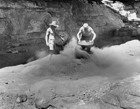 Fred McCarthy and Frank M Setzler shovelling and sifting cave deposits in front of picture gallery, Gunbalanya, October 1948.