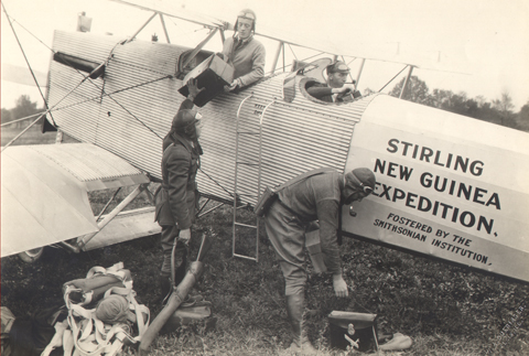 Four American expedition members with the Expedition's airplane (the Ern) as they set out from Maywood, Illinois in 1925.