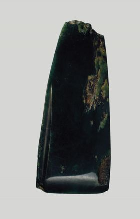 Adze blade made of dark-coloured greenstone.