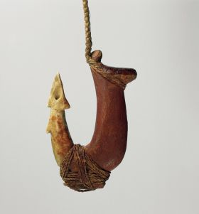 Two-part fishhook made of wood with twisted cord and lashing made of plant material.