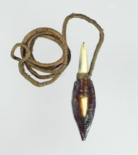 A harpoon point made of a concave piece of mussel shell, cemented between two pieces of pointed bone, with thick, twisted cord affixed to the underneath of the shell tip.