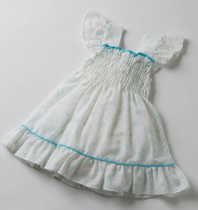 White child's dress with smocked front and aqua trim.