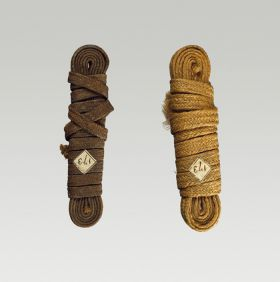 Two bands  made of plaited flax and wound up.