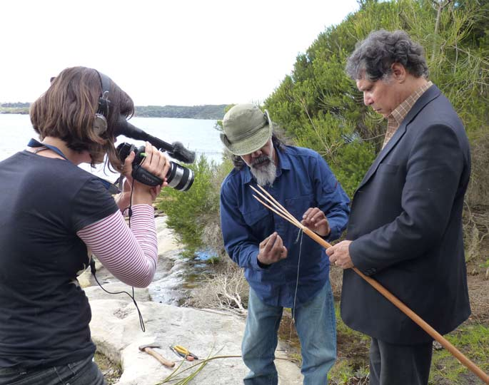 Shayne Williams being filmed making a gararra fishing spear