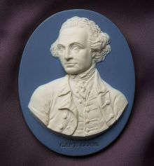 Cameo-style engraving in relief showing a man's portrait with 'Capt Cook' inscribed in print at the base.