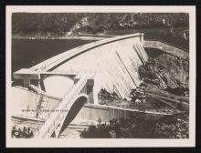 Black and white photograph showing a dam and dam wall.