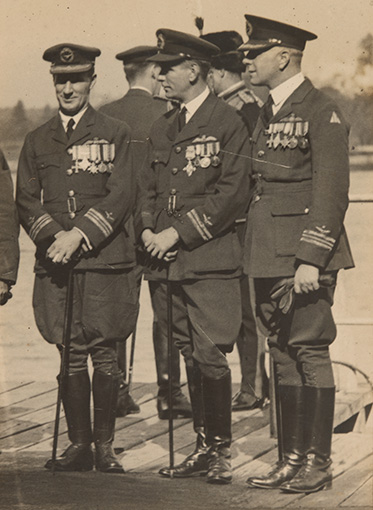 A black and white photo of Kingsford Smith in full RAAF uniforms with canes.