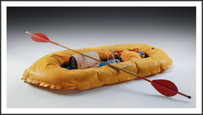 studio photo of a raft with a paddle.