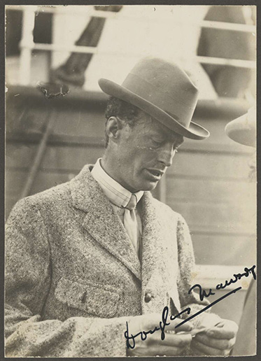 black and white photo of man in suit and hat