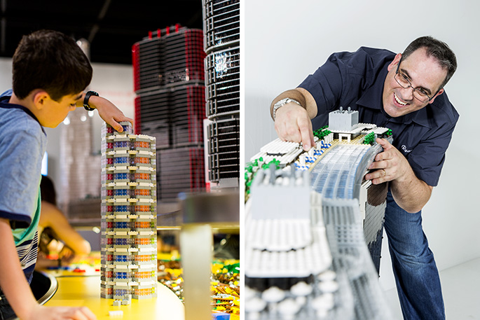 A man and a boy building towers with LEGO bricks.On the left is boy