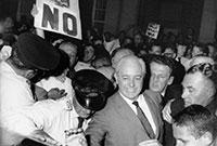Man standing amidst demonstration