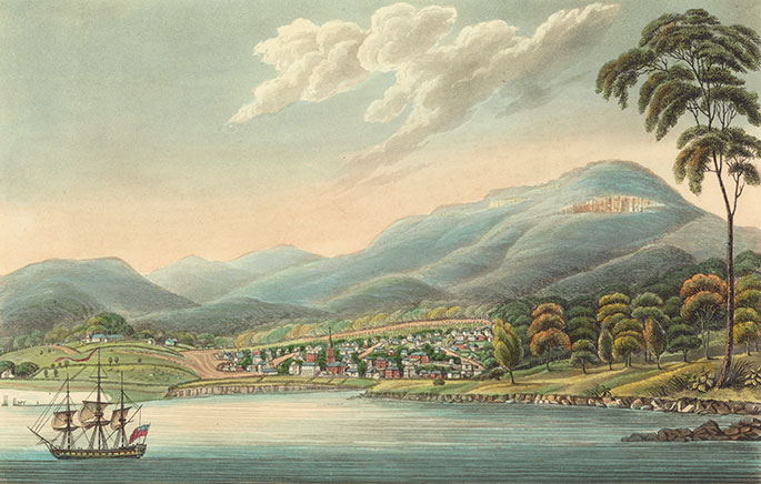 Colour picture showing a small town on the edge of a harbour. A ship is in the foreground; hills are in the background