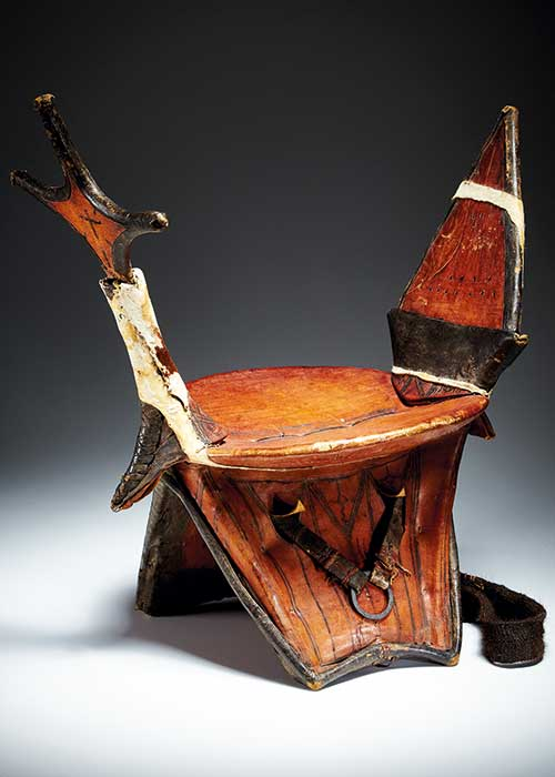 A camel saddle made from wood, cut metal, leather and natural pigments - click to view larger image