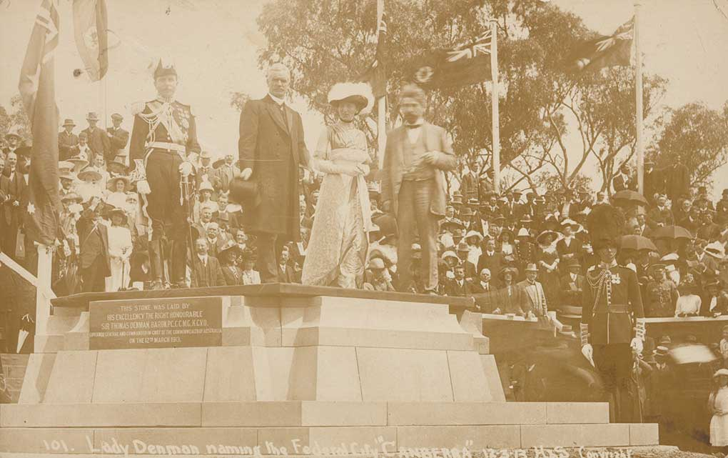Black and white photograph of dignatories and people at the official ceremony to make the commencement of work on the city of Canberra