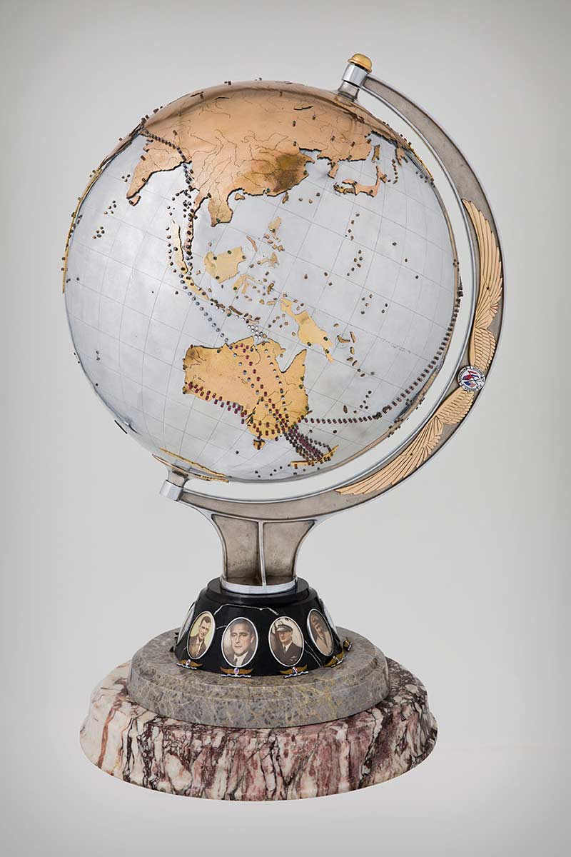 Silver-plated aluminium globe of the world marked with the flights of the Southern Cross - click to view larger image