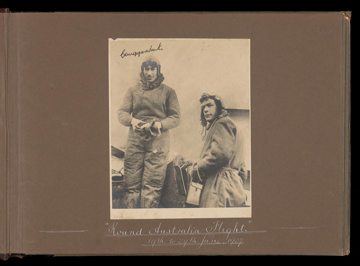Kingsford Smith and Ulm in flying clothing and helmets - click to view larger image