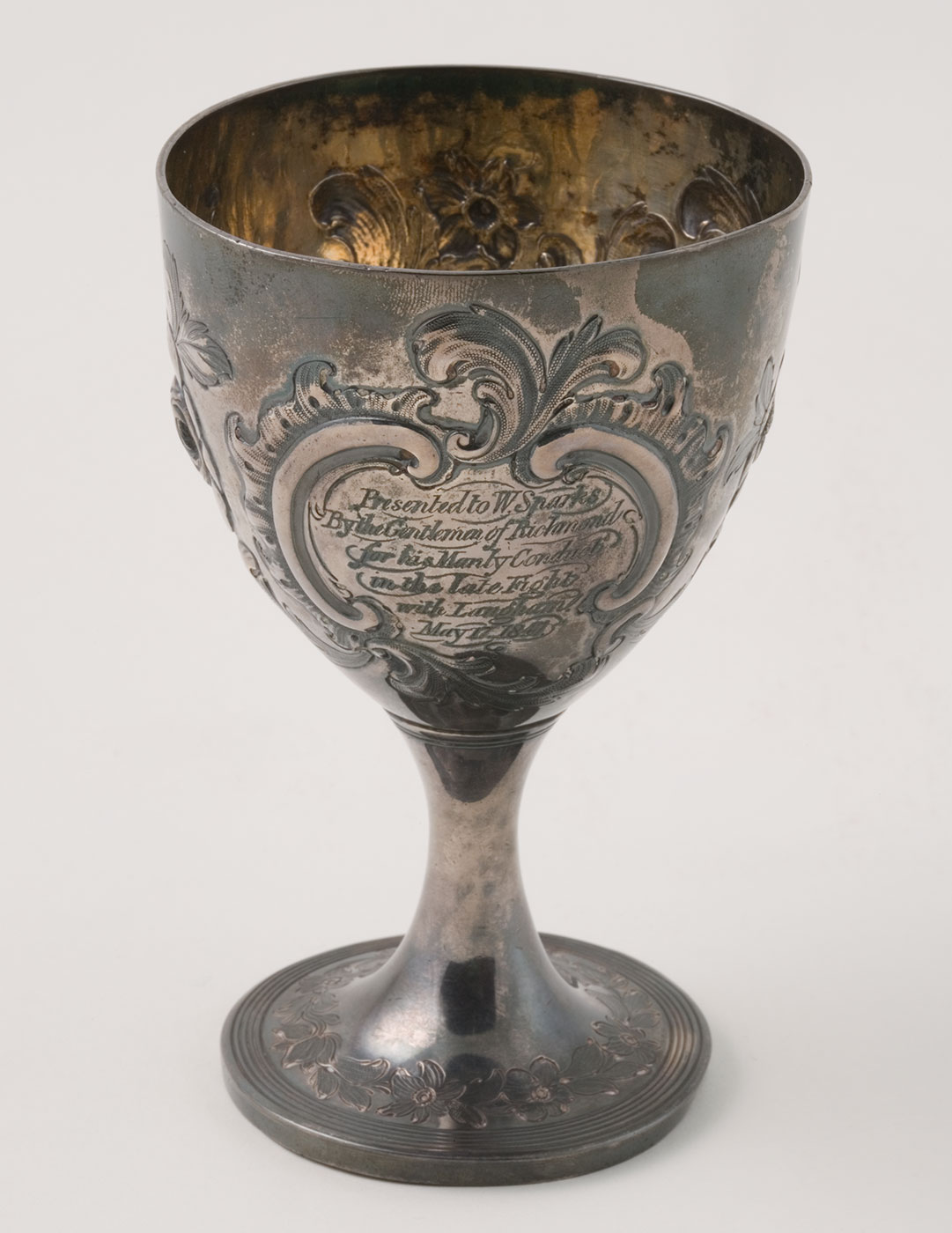 An engraved solid silver goblet.
