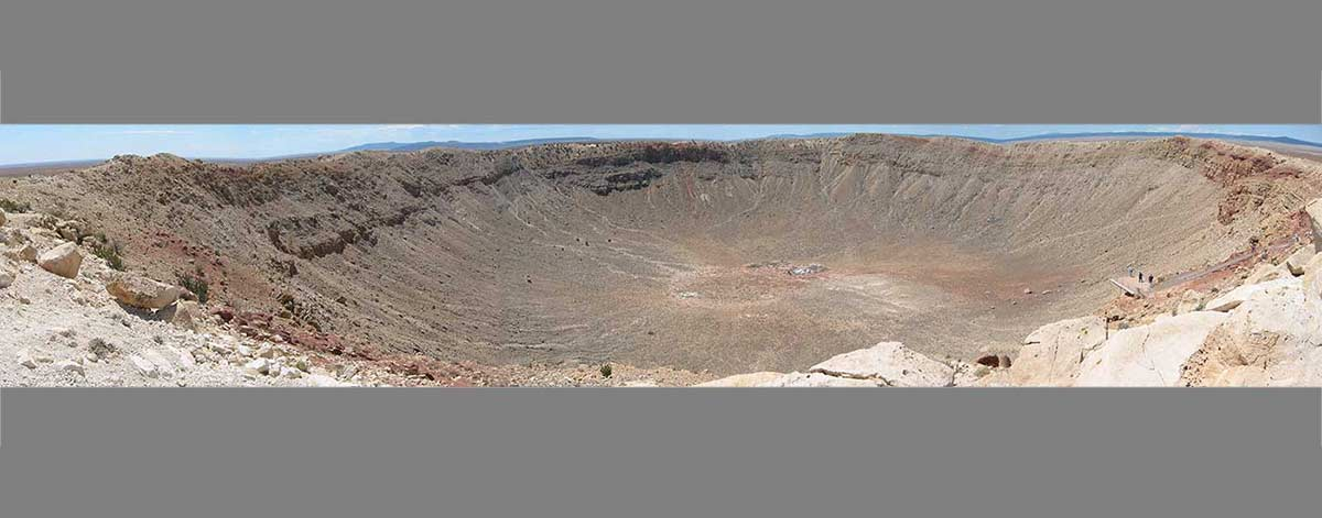 Aerial view of a large, circular depression in the earth's surface. - click to view larger image