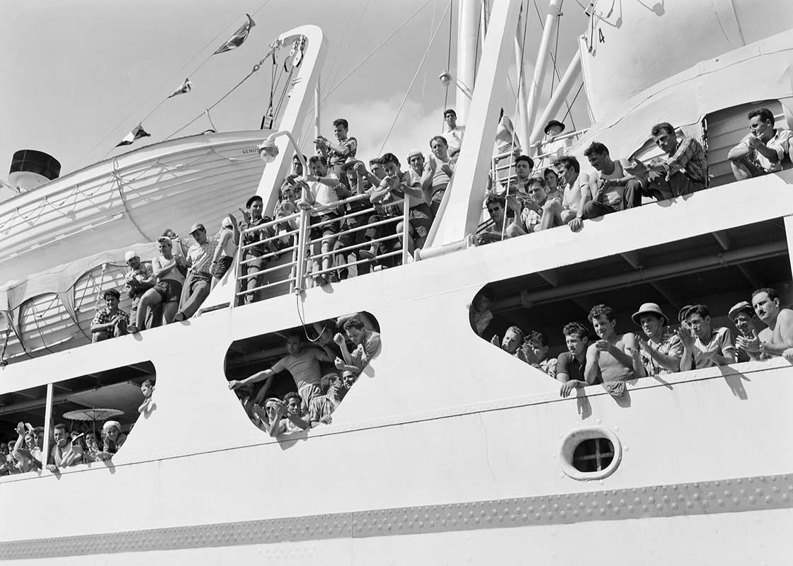 Young men arrive in Australia aboard a ship