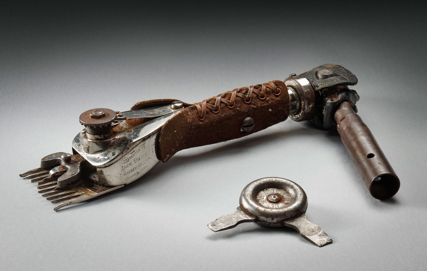 Shearing handpiece with metal blade and handle wrapped in leather - click to view larger image