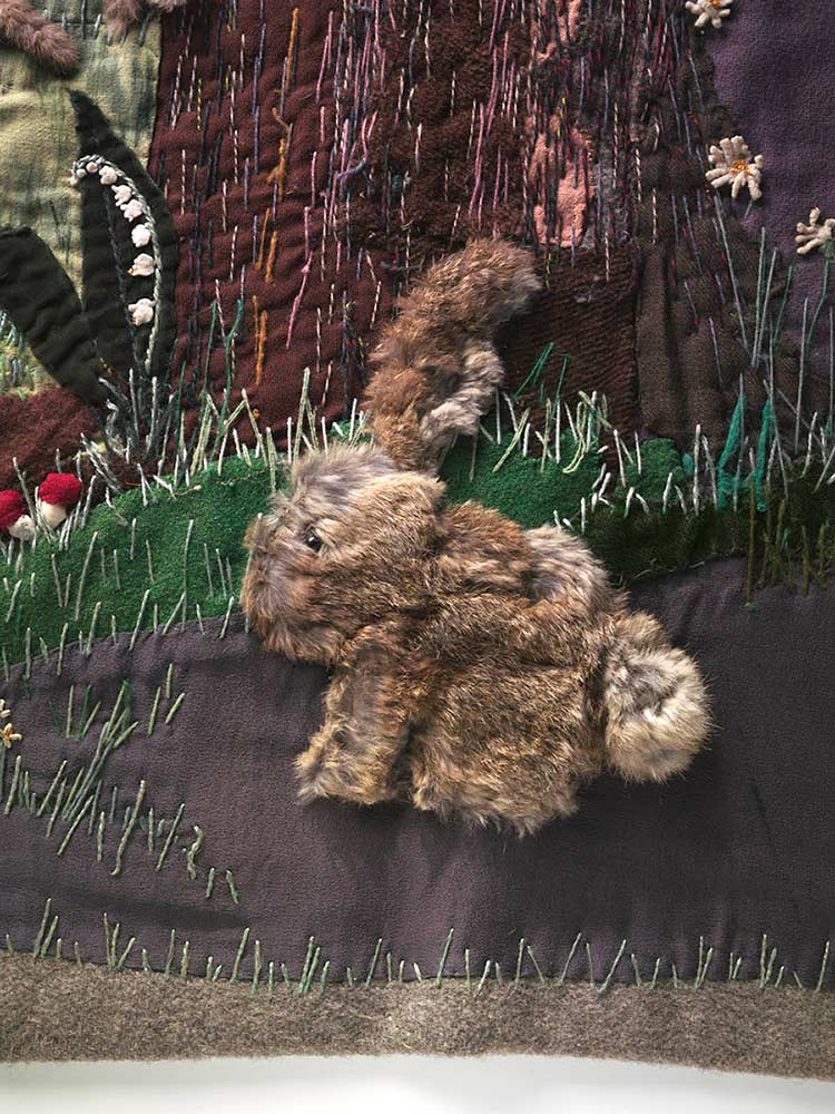 Detail from the Little Red Riding Hood wall-haning depicting a rabbit made fur and a variety of other fabrics including felt. - click to view larger image