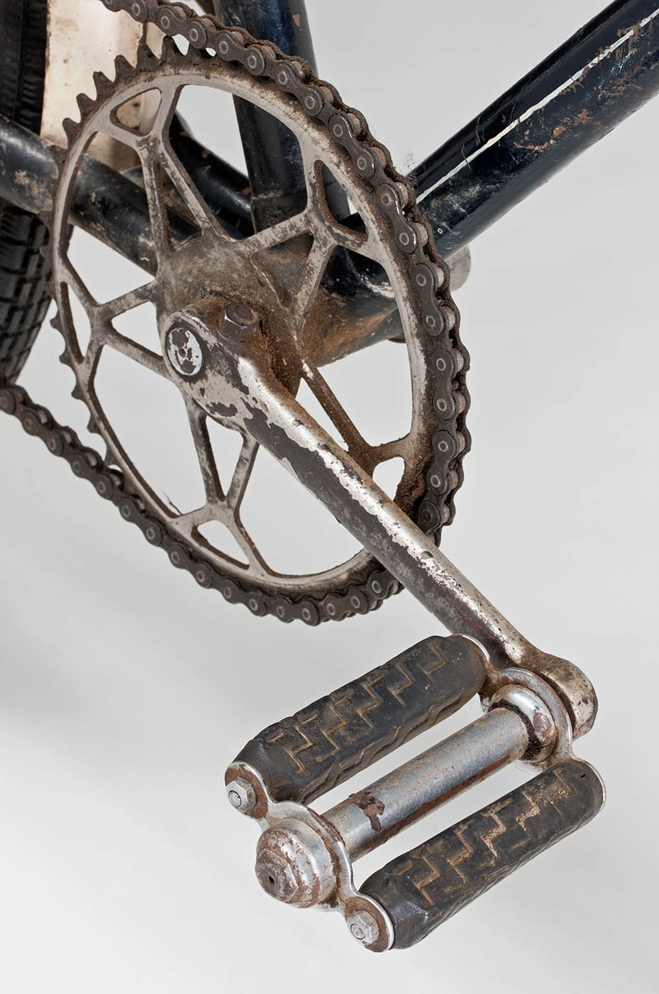 A bike chain and pedal. - click to view larger image